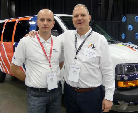 Radu Mihai, Burnco Rock Products and Ralph Tricomi, XL Hybrids with and electrified GM commericial van at the vendor fair