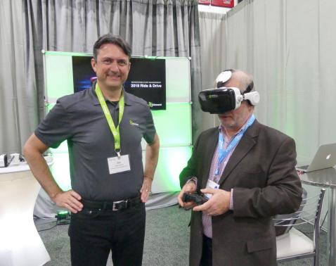 Jim Williamson, Element Fleet Management and James Moore, Scotiabank at the virtual reality driver training stop at the digital village