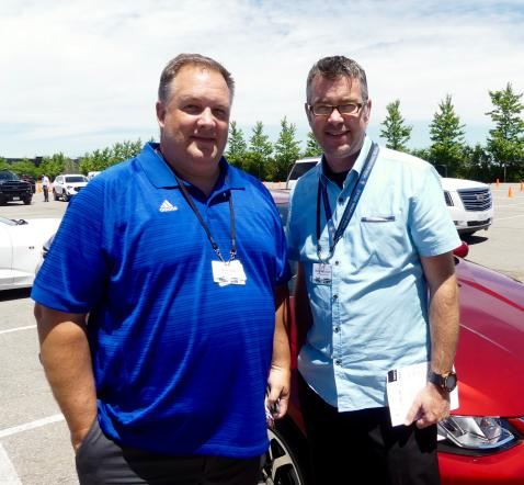 Jason Dow and Martin McCulloch, York Region Police, check out a Chevrolet Cruze