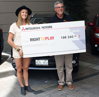 Georgia Simmerling, a Right To Play Athlete Ambassador and Olympic ski cross athlete with Tony Laframboise, Mitsubishi Motor Sales of Canada