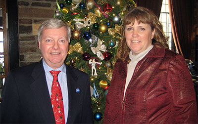 Chris Hill and Jennifer Chapman, co-organizers of the event taking a moment by the Christmas Tree