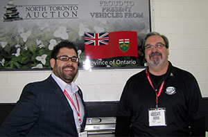 (From left) Christian Panza, Norrth Toronto Auction, and Mike Cole, Ontario Ministry of Transportation celebrate at the 10th anniversary auction.
